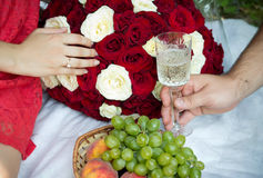 Hands of lovers on live story. Hands of lovers with a ring, union and champagne Stock Photos