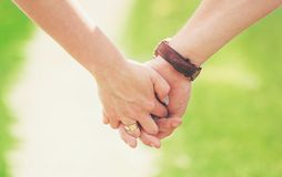 Hands of lovers. Love. Hands of lovers. Selective focus stock photos