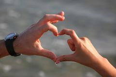 Hands of lovers made a figure of the heart. Closeup Royalty Free Stock Photo