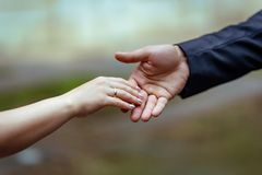 Hands of lovers man and woman stock images