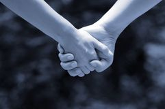Hands of lovers(monochrome). Two lovers are walking  hand in hand Stock Photo