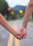Hands of lovers. Two lovers are walking hand in hand Royalty Free Stock Image