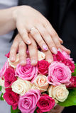 hands  lying on the bridal bouquet Stock Photography