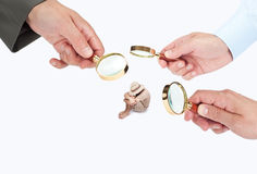 Hands with magnifier glasses looking at a person Royalty Free Stock Photography