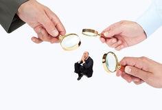 Hands with magnifier glasses looking, studying or selecting a person Stock Photo