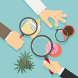 Hands with magnifying glass. Concept of searching, detecting and analyzing. Desk top view Stock Image