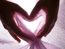 Hands make heart from cloth. Hands make shape of heart from pink cloth Royalty Free Stock Images