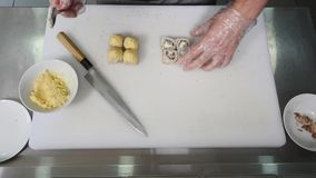 Hands make sushi roll. Sushi chef demonstrating skill. Famous japanese dish stock video footage