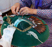 Hands making  bobbin lace Royalty Free Stock Photo