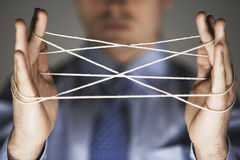 Hands Making Cat's Cradle Royalty Free Stock Image