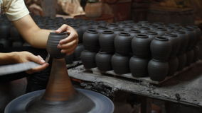 Hands making clay pot stock video