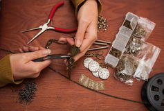 Hands making craft jewellery Royalty Free Stock Photos