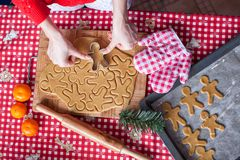 Hands making from dough Christmas gingerbread man Stock Photography