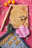 Hands making from dough Christmas gingerbread man Stock Photos