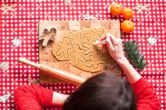 Hands making from dough Christmas gingerbread man Royalty Free Stock Image