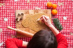 Hands making from dough Christmas gingerbread man Stock Image