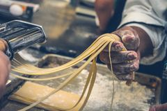 Hands making fresh pasta Royalty Free Stock Photo