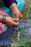 Hands making garlands, Kathmandu, Nepal Stock Photo