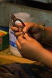 Hands making golden ring, Kathmandu, Nepal Royalty Free Stock Photo