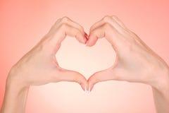 Hands making heart Stock Photo