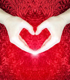 Hands making heart on red fluffy background.Valentine`s day concept.Love concept.peace. Stock Photos