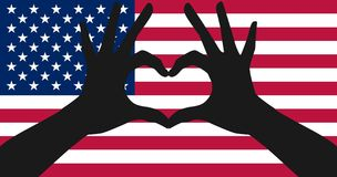 Hands making a heart shape on american flag Royalty Free Stock Photos