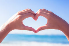 Hands making heart shape on the beach Royalty Free Stock Photography