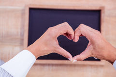 Hands making heart shape Royalty Free Stock Photos
