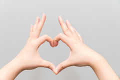 Hands making a heart shape Stock Photo