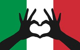 Hands making a heart shape on italian flag Royalty Free Stock Photo