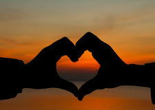 Hands making heart shape Stock Photos