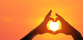Hands making a heart shaped symbol royalty free stock photos
