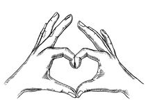 Hands making heart sign engraving vector. Illustration. Scratch board style imitation. Hand drawn image Stock Photos