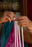 Hands making pearl necklace, Kathmandu, Nepal Stock Photos