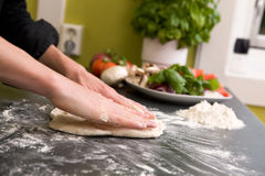 Hands making pizza - detail Royalty Free Stock Photos