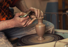Hands making pottery Stock Images
