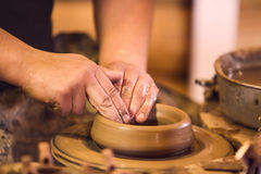 Hands making pottery on a wheel Stock Images