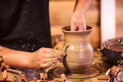 Hands making pottery on a wheel. Close-up of hands making pottery on a wheel Royalty Free Stock Photography
