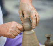 Hands making pottery on a wheel Royalty Free Stock Images