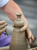 Hands making pottery on a wheel Royalty Free Stock Photos