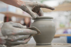 Hands Making Pottery On A Wheel Stock Photo