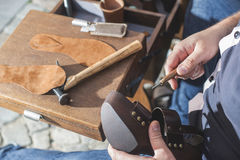 Hands making shoes royalty free stock photography