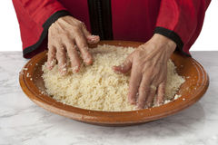 Hands making traditional Moroccan couscous Stock Images