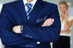 Hands of male businessman in blue suit crossed on chest. In office. Serious business, stock or foreign exchange market, job offer, excellent education, advisor Stock Images