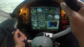 Hands of male pilot navigating plane with steering wheel, aircraft falling down. Stock footage stock footage