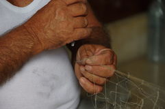 The hands of Maltese fisherman Royalty Free Stock Image