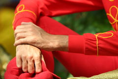 Hands of a man. In a red kimono Stock Image