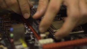 Man assembling motherboard. Close-Up. Hands of a man assembling motherboard. Close-Up stock video footage