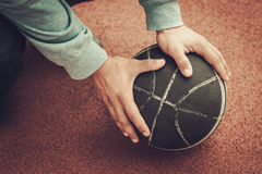 Hands of a man on a basketball ball.  royalty free stock photo