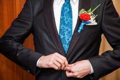 Hands of man in black suit Stock Photos